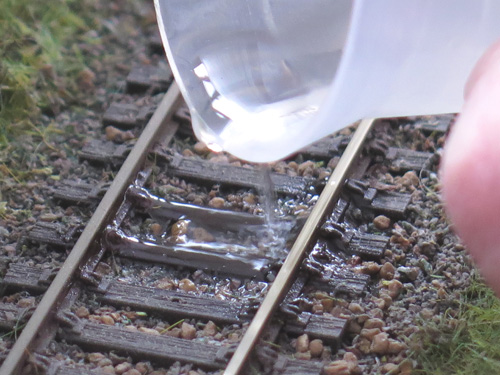 never pour neat Track Magic onto the track.