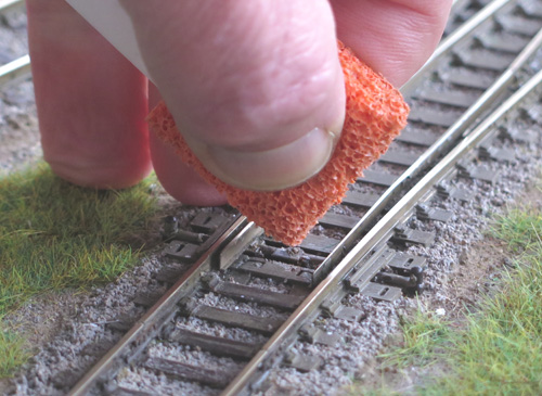 do not squeeze Track Magic out of the foam applicator pad.